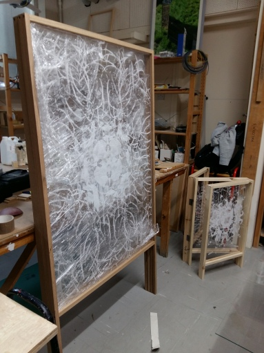 Two of my finished frames stacked up. It's nice to see the comparison with my maquette in the bottom right.
